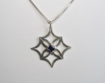 Sterling silver and iolite geometric pendant