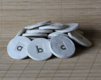 Back to School. Baby Gift. ABC coins, Handmade Stoneware, 26 lowercase alphabet coins in an organic cotton gift bag