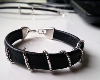Black leather bracelet with silver beads