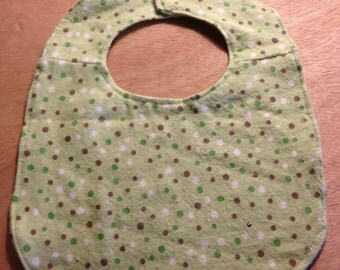 Baby bib with snap clasp