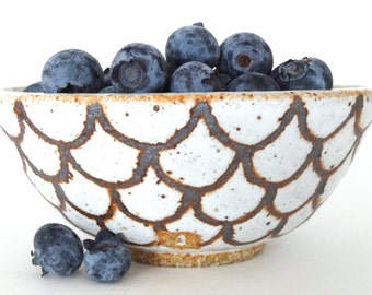 Small handmade ceramic bowl in gloss white with iron-oxide design