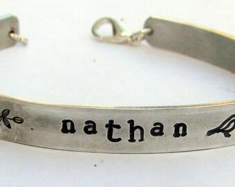 Personalized name bracelet: aluminum hand-stamped bracelet.