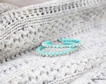 Earrings with silver rhinestones