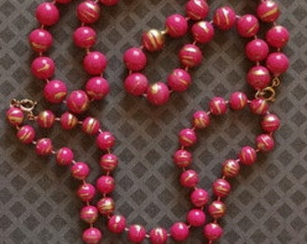 Hot Pink Beads with Gold Accents 2 separate strands 1 is 10 mm and the other is 13mm