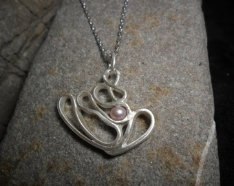 Sterling silver with a Pearl pendant with rose