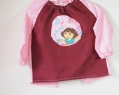 Art smock for toddler age 2 to 3 years. Burgundy and pink Dora.