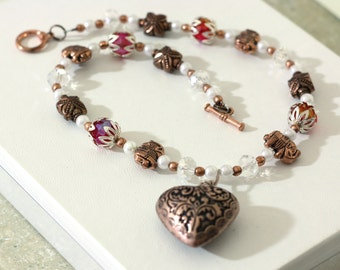 Antique Copper Heart Pendant Beaded Necklace features pink and white crystal beads with copper spacer beads and copper elephant charms