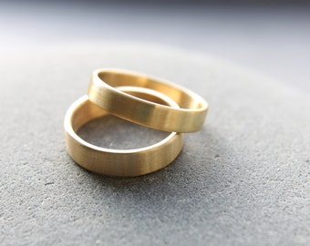 4mm + 5mm wedding ring set in 18ct yellow gold, flat profile, brushed finish - made to order from recycled materials