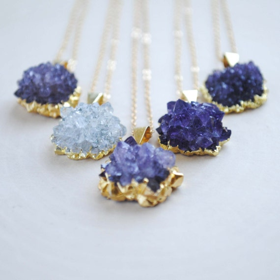 Love these amethyst geode necklaces