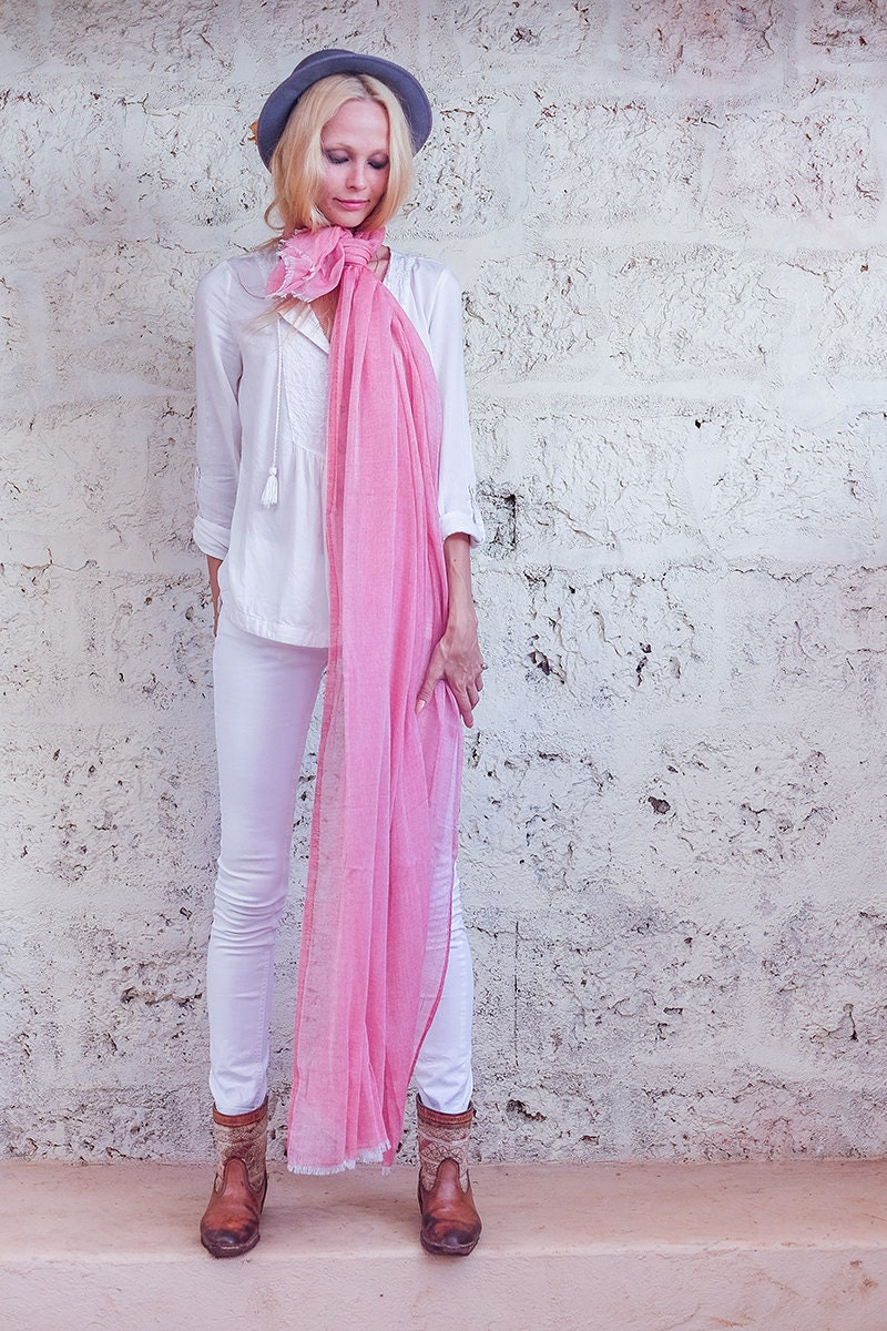 Wrap up in style with a cute scarf! Whether you choose a light and airy scarf for a summer evening or a cozy, ribbed scarf for a chilly day, our scarves for women are sure to add charm to any look.