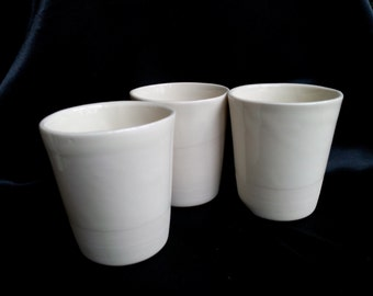 Beautiful slipcast porcelain mugs. Microwave safe.