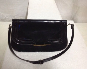 shiny leather bag 70 years