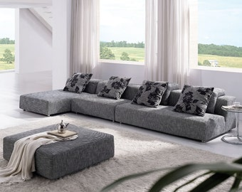 modern zebrano fabric sectional sofa with flower pattern pillows and matching ottoman model. Black Bedroom Furniture Sets. Home Design Ideas
