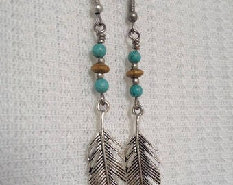 Bohemian earrings with metallic feather and turcoise  beads