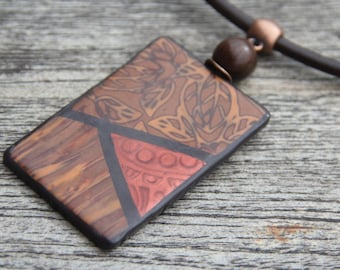 """Rectangular ethnic pendant collection """"Foliages"""" in polymer, colors copper and brown, on leather cordon"""
