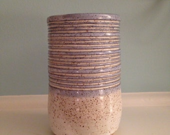 Sale Vase. Blue with concentric circles. Ceramic stoneware. Hand thrown pottery. White ceramic vase. Speckled stoneware. Cool, unique vase.
