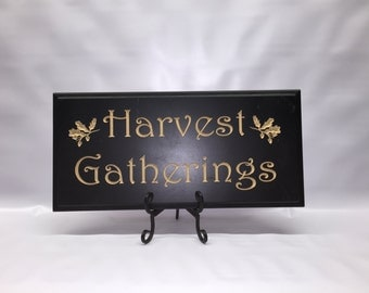 """Carved """"Harvest Gatherings"""" sign"""