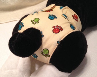 Doggie diapers. Printed Cotton fabric outside with solid flannel lining.