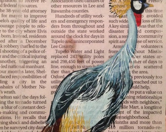 Painted crane on newspaper
