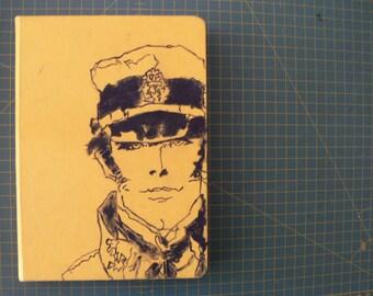 Handmade notebook, elastic closure. Hand painted illustration on the cover. Corto Maltese!