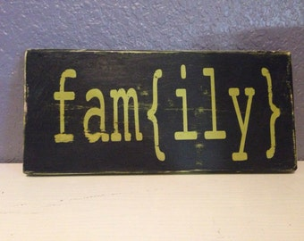 Fam{ily} wood sign