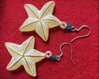 Yellow starfish earrings with an azure bead