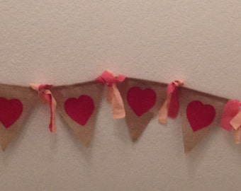 A beautiful burlap garland with cotton fabric accents. Perfect for Valentine's with its artsy red hearts.