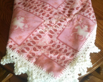 Custom Embroided Fleece baby blanket with crocheted edging.
