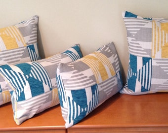 Teal/mustard/grey geometric cushion