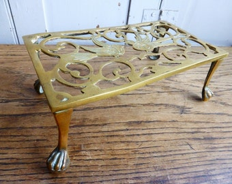 Antique Victorian brass trivet pot stand with birds decoration