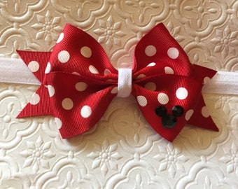 Mickey Mouse red bow with white polka dots on a white elastic band
