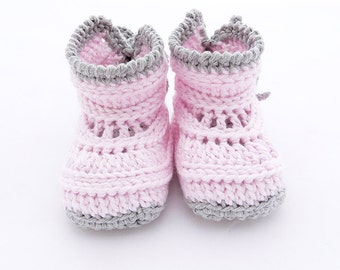 Crochet baby booties pink and grey. Alasias Baby booties model