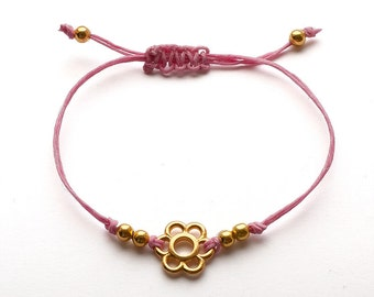 Cute tiny little cord bracelet with flower charm