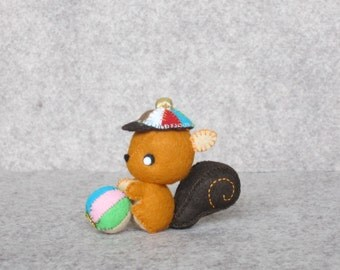 Felt squirrel with the peaked cap and his ball