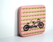 tile with 2 prints on a painted surface, of green dashes & a tandem bicycle, made to order.