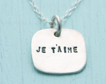 JE T'AIME necklace, French 'I love you' pendant, eco-friendly silver. Handcrafted by Chocolate and Steel