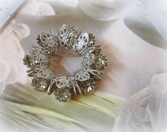 vintage rhinestone wreath brooch . silver tone filigree prong set black diamond rhinestones circa 1960s