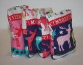 HANDWARMERS or BOOBOO BAGS. reusable handwarmers/ice packs set of two. merry reindeer