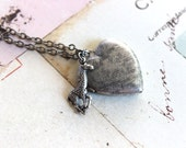 giraffe locket necklace. silver ox with etched lines heart