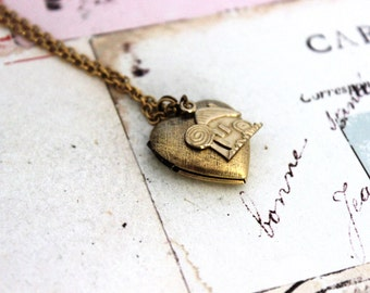 fairy house. heart locket necklace. in gold ox with etched lines locket