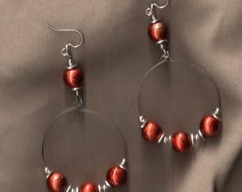 Tangerine beaded dangle earrings.