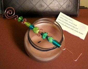 handmade copper candle snuffer with green teal glass beads