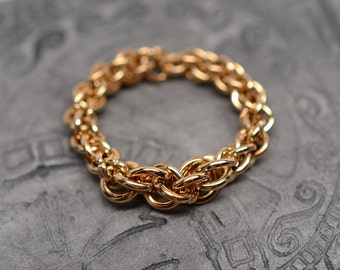 Jewelers brass graduated jens pind spiral braided chainmaille ring
