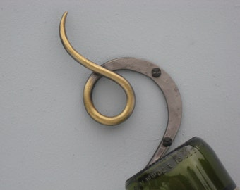 hand forged wine holder with brass accent by Pa Blacksmith ark Iron