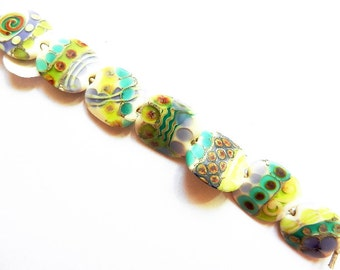VENICE    7 ivory, silver, teal, ink, grass, opal yellow and raku matte finish small squeezed    A Beaded Gift