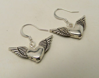 Steampunk earrings. Winged heart earrings.