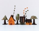 Houses and trees. Miniature. Orange and green shades.