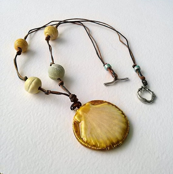 ceramic shell necklace on waxed linen cord by rhealeanne