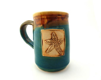 Handmade Pottery Mug Starfish in Brown and Teal ceramics and pottery by Jewel Pottery