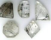 5 Black Rutilated Quartz cabochons, abstract shapes, 123.19 carats total              069-18-016